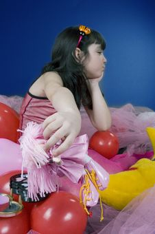 Young Girl Angry On Her Doll Royalty Free Stock Image