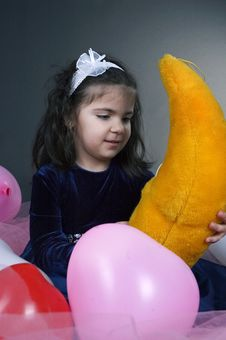 Sweet Young Girl Playing With Her Plush Moon Stock Photography
