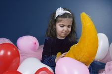 Sweet Young Girl Playing With Her Plush Moon Stock Photos