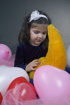 Sweet Young Girl Playing With Her Plush Moon Royalty Free Stock Photo