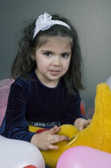 Sweet Young Girl Playing With Her Plush Moon Royalty Free Stock Image
