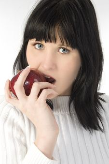 Free Beautiful Young Woman Eating Apple Royalty Free Stock Photography - 619457