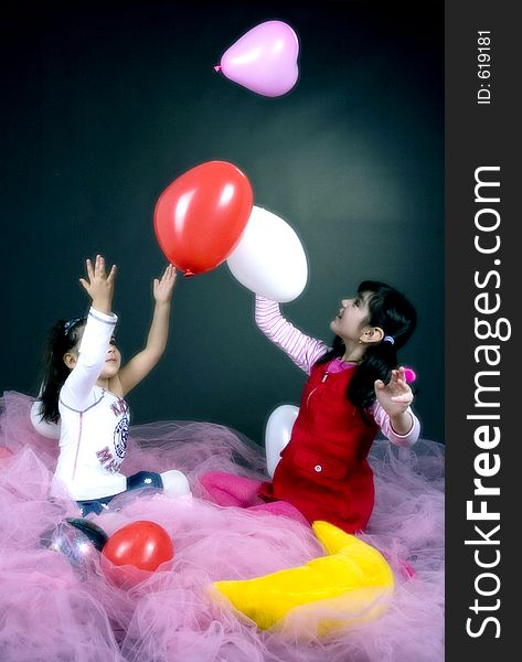Young girls playing with balloons