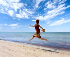 Free Girl Running Along Sea Coast Royalty Free Stock Photography - 6100467