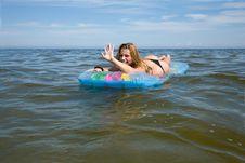 Free Beautiful Girl Swimming On Mattress Stock Photo - 6101380