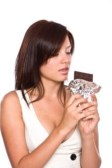 Free The Young Beautiful Girl Eats Chocolate. Royalty Free Stock Photos - 6101628