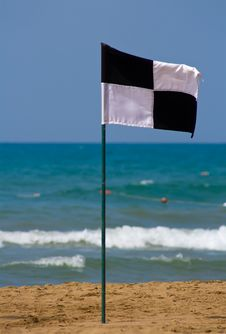 Quartered Black And White Flag On The Beach Royalty Free Stock Photography