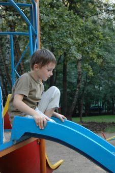 Free Boy On The Pleasure-ground In Park. Stock Image - 6102581