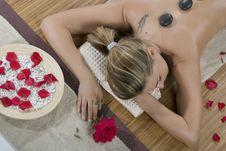 Woman Having Hot-stone Massage Stock Images