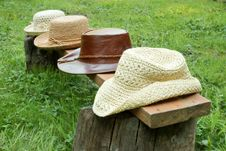 Hats In A Rown On Bench Royalty Free Stock Photo