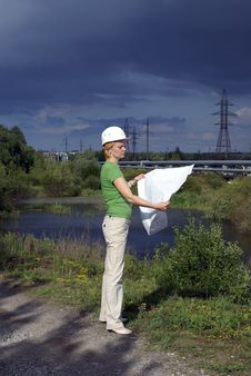 Woman Engineer With White Safety Hat Drawings Stock Photo