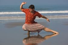 Free Man Is Doing East Gymnastic On The Beach Stock Photography - 6106512