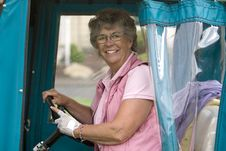 Woman In Golf Cart Stock Images