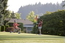 Free Couple Playing Golf - Horizontal Royalty Free Stock Photography - 6106997