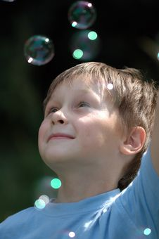 Free Beautiful Boy Blowing Soap Bubbles Outdoors. Royalty Free Stock Images - 6106999