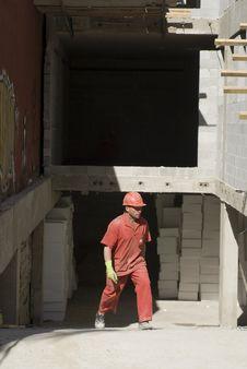 Free Worker Walks Across Jobsite - Vertical Royalty Free Stock Image - 6107096