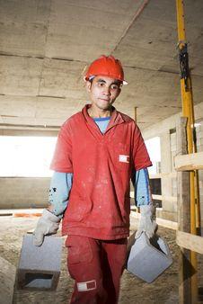 Free Worker Carries Cinder Blocks Stock Image - 6107121
