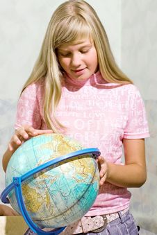 Schoolgirl & Globe Stock Photos