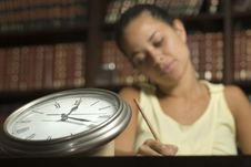 Free Woman Seated By Clock - Horizontal Stock Photography - 6107632