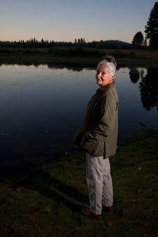 Lady At The Lake Stock Photos