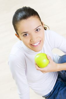 Woman Eating Fresh Green Apple Stock Images