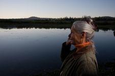 Lady At The Lake Stock Photo