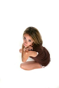 Free Squatting Teen Blowing Kiss Royalty Free Stock Photography - 6109017