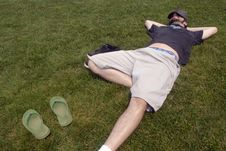 Free Man Resting In Grass Stock Photography - 6110312