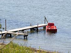 Small Wooden Pier Jetty With Armchair Stock Image