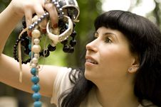 Free Brunette Holding A Lot Of Beads Royalty Free Stock Photography - 6119477