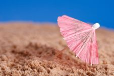 Red Parasol On Beach Sand With Blue Sky Background Royalty Free Stock Image