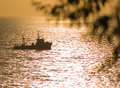 Free Small Fishing Ship Floating On Sunset Royalty Free Stock Photography - 6127267