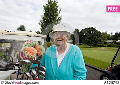 Free Female Golfer With Cart Royalty Free Stock Photos - 6125798