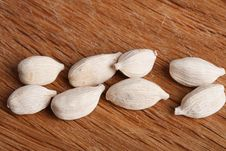 Free Eight White Cardamom Pods On Old Wood Royalty Free Stock Images - 6120069