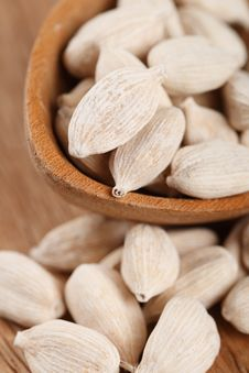Free White Cardamom In Wooden Spoon Stock Photography - 6120072