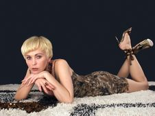Free Blonde Is Lying On The Carpet Thoughtfully. Royalty Free Stock Image - 6120106