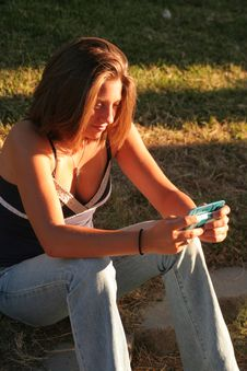 Moody Lighting Of Teen Text Messaging Royalty Free Stock Photo
