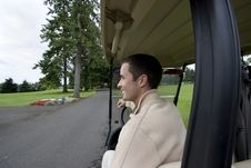 Free Man Seated In Golf Cart Royalty Free Stock Image - 6120626