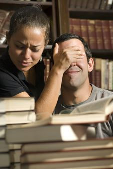 Free Woman Covers Man S Eyes In Library - Vertical Royalty Free Stock Photos - 6120898