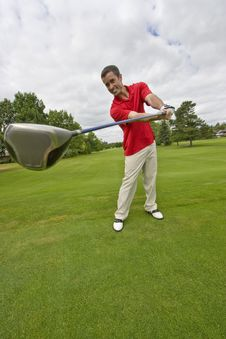 Free Man With Golf Club - Vertical Royalty Free Stock Image - 6125656