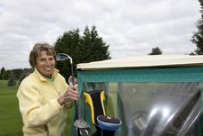 Female Golfer With Cart Royalty Free Stock Photo