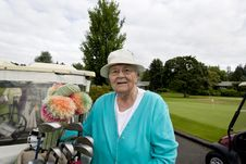 Female Golfer With Cart Royalty Free Stock Photos
