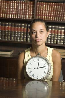 Woman Sitting Behind Clock - Vertical Stock Photo