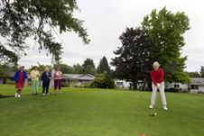 Free Woman Teeing Off Royalty Free Stock Photos - 6125878