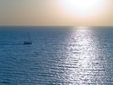 Small Yacht Floating In The Sea Royalty Free Stock Photos
