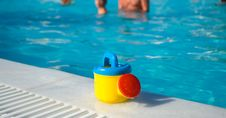 Free Cute Child S Watering-can At The Pool Stock Photography - 6128082