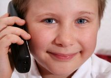 Free Young Boy On The Phone Stock Photos - 6128373