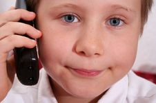 Free Young Boy On The Phone Royalty Free Stock Photo - 6128405