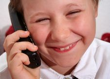 Free Young Boy On The Phone Stock Photos - 6128433