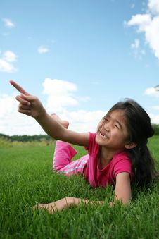Free Little Girl Lying On Grass Royalty Free Stock Photo - 6128505